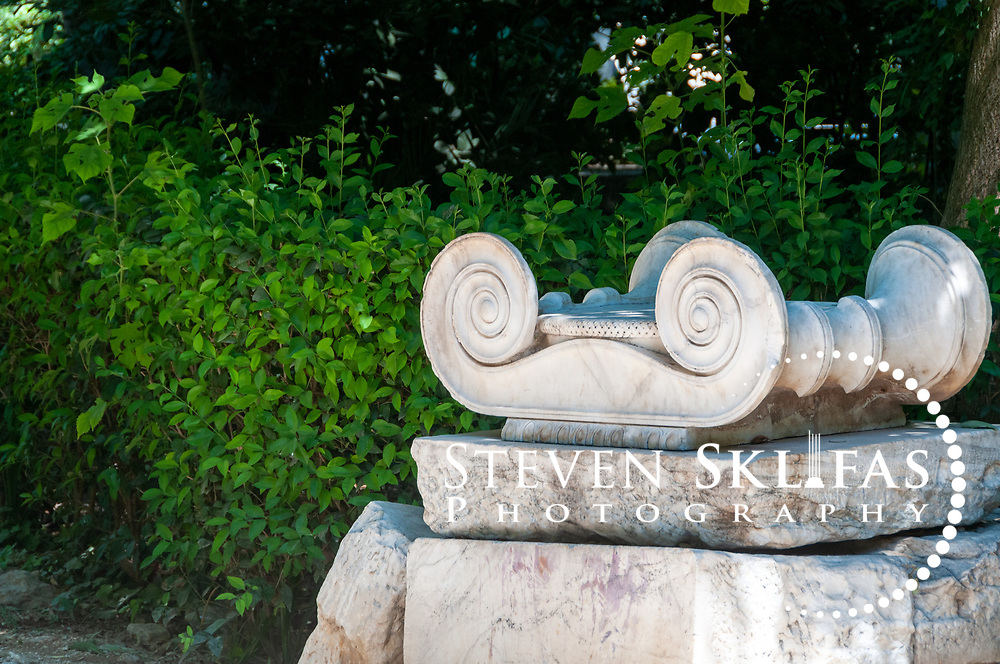 Athens. Greece. View of architectural fragments from antiquity in the grounds of the National Gardens, a vast green refuge and oasis in the centre of Athens. The National Gardens was formerly the Royal