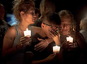 Mona Rodriguez comforts her 12-year-old son, J Anthony Hernandez, during a candlelight vigil held for the victims of a fatal shooting at the First Baptist Church of Sutherland Springs, Sunday, Nov. 5, 2017, in Sutherland Springs, Texas. NICK WAGNER / AMERICAN-STATESMAN