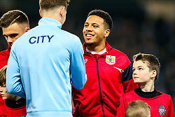 Korey Smith of Bristol City greets John Stones of Manchester City - Rogan/JMP - 09/01/2018 - Etihad Stadium - Manchester, England - Manchester City v Bristol City - Carabao Cup Semi Final First Leg.