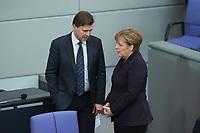17 FEB 2016, BERLIN/GERMANY:<br /> Steffen Seibert (L), Regierungssprecher, und Angela Merkel (R), CDU, Budneskanzlerin, im Gespräch, vor Beinn der Sitzung mit Regierunsgerklaerung der Bundeskanzlerin zum Europaeischen Rat, Plenum, Deutscher Bundestag<br /> IMAGE: 20160217-03-004<br /> KEYWORDS: Debatte, Gespräch