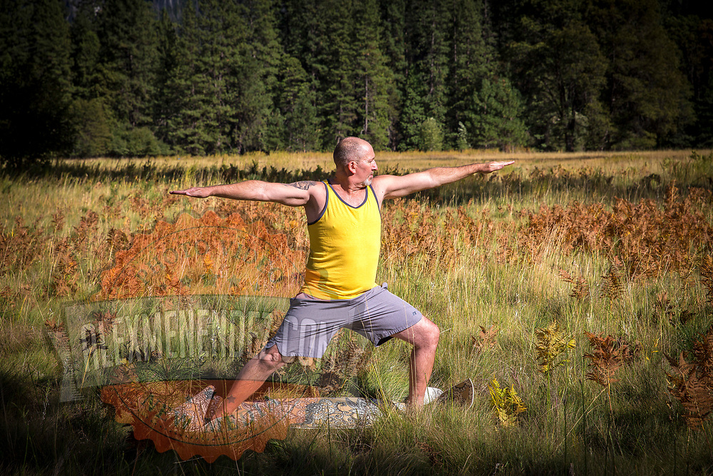 A person performs yoga in a meadow inside Yosemite National Park on Sunday, September 22, 2019 in Yosemite, California. (Alex Menendez via AP)