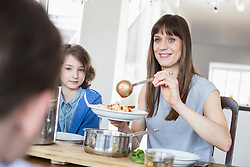 Mother hand overing meal to childrens