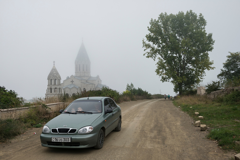On a misty afternoon, a car drives past the Holy Savior Cathedral, or Ghazanchetsots Cathedral, in Shushi (Shusha), in the disputed region of Nagorno-Karabakh. Built in the 1880s, it is the seat of the Diocese of Artsakh of the Armenian Apostolic Church.<br /> <br /> (September 23, 2016)