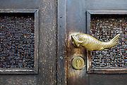 Fish-shaped door handle, Makarska, Croatia