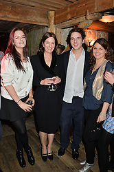 Left to right, DAISY CECIL, MINNIE CECIL, TOM CECIL and GERALDINE HARMSWORTH at a party in honour of the Walking With The Wounded team members held at Bodo's Schloss, 2A Kensington High Street, London on 13th November 2013.