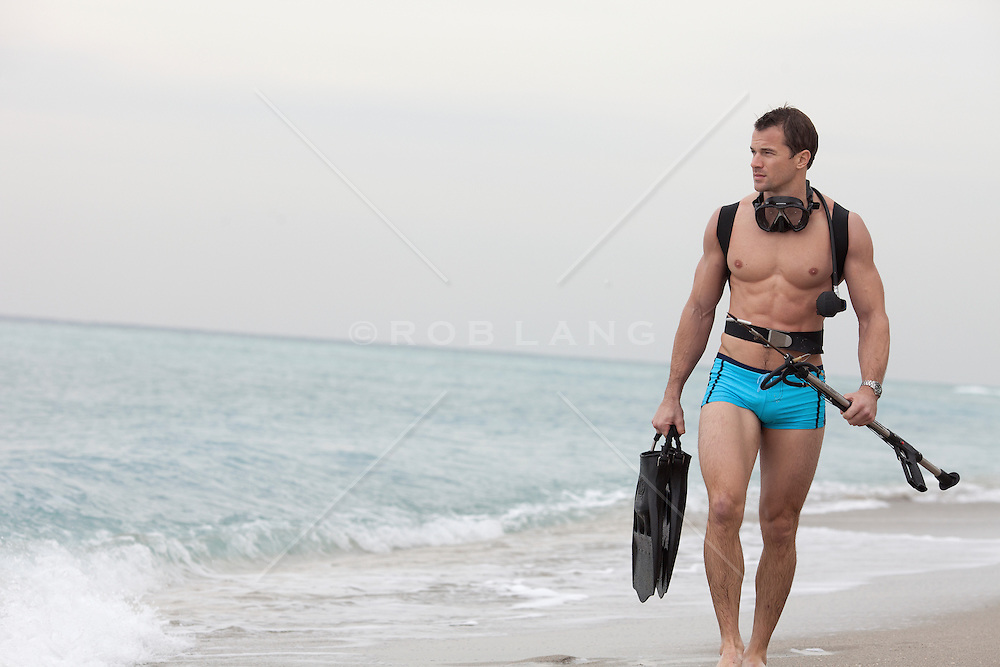 very handsome man with a snorkel and mask at the beach in Florida