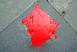 Edinburgh, Scotland, UK. 12 July, 2020. Trans community protestors vandalised JK Rowling handprints with red paint outside City Chambers in Edinburgh city centre.  Iain Masterton/Alamy Live News