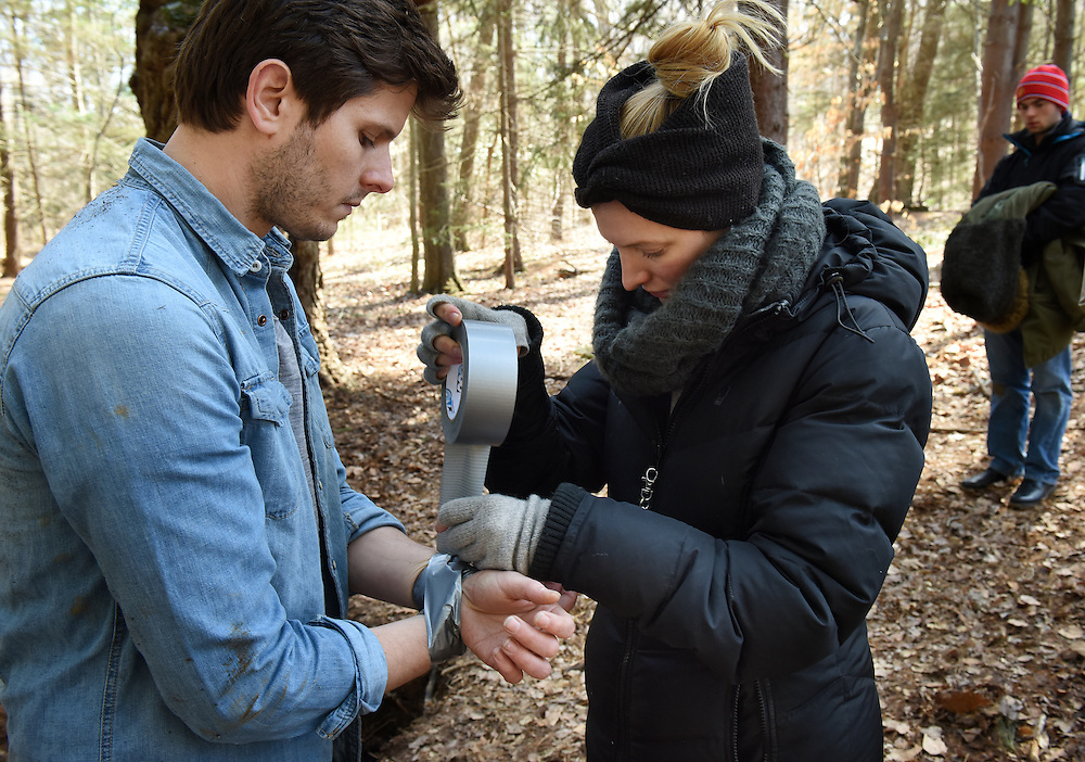 """April 5, 2016, Guilford, CT<br /> Mara Lavitt -- Special to the Hartford Courant<br /> Guilford native Matt Newton of Greenwich on his family's property in Guilford making his horror short-film """"Hide/Seek."""" Actor Bryan Manley Davis of Brooklyn has his hands tied with duct tape for a scene by Newton's wife and the film's art department Liana Newton."""