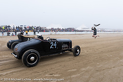 A once in a lifetime moment - as TROG organizer in his skivies drops the flag for Katie Hill in her 1927 Ford model-T Roadster at TROG West - The Race of Gentlemen. Pismo Beach, CA, USA. Saturday October 15, 2016. Photography ©2016 Michael Lichter.