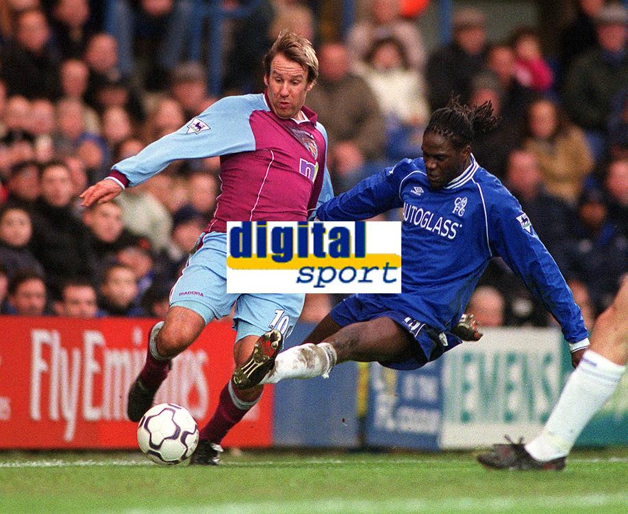 Paul Merson (Aston Villa) tackled by Mario Melchiot (Chelsea). Chelsea v Aston Villa. FA Premiership, 1/1/01. Credit: Colorsport / Andrew Cowie.
