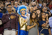 Milpitas fans cover their hearts during the National Anthem before taking on Valley Christian High School during Friday Night Lights at Levi's Stadium in Santa Clara, California, on September 18, 2015.  Milpitas went on to lose 22-21 against Valley Christian.  (Stan Olszewski/SOSKIphoto)