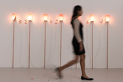 "© Licensed to London News Pictures. 22/06/2016. London, UK. A staff member walks by the ""Capsule"" light installation by Wanda Wieser at the annual exhibition of works by artists graduating from the UK's longest established art school, RA Schools Show, at the Royal Academy in Piccadilly.  Works from 17 emerging artists are on show 23 June to 3 July. Photo credit : Stephen Chung/LNP"