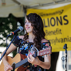 Mechanicsburg, PA, USA - June 21, 2018: Local musician and singer Alex Allegra performs downtown during Jubilee Day, the largest, longest running, one-day street fair on the East Coast.