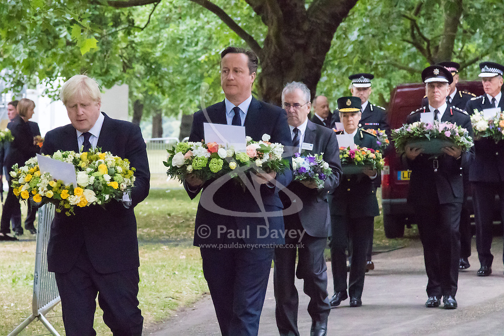 Hyde Park, London, July7th 2015. The Mayor of London Boris Johnson and other senior political figures, the Commissioners for transport and policing in the capital, as well as senior representatives of the emergency services  lay wreaths at the 7/7 memorial in Hyde Park. PICTURED: Mayor of London Boris Johnson and Prime Minister David Cameron lead the sombre procession of senior politicians and representatives of the emergency services towards the 7/7 Memorial monument.