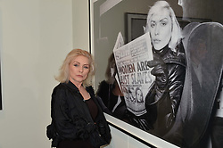 DEBBIE HARRY at a private view of Chris Stein/Negative: Me, Blondie And The Advent Of Punk, held at Somerset House, The Strand, London on 5th November 2014.