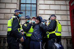 © Licensed to London News Pictures. 28/11/2020. London, UK. Police arrest an anti-lockdown protester in Westminster during a demonstration against Coronavirus restrictions. Tiered restrictions will be reintroduced when the England-wide lockdown ends on 2 December. Photo credit: Rob Pinney/LNP