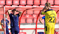 Oxford United's Rob Atkinson leaves the field after he was shown a red card by referee Andy Davies<br /> <br /> Photographer Chris Vaughan/CameraSport<br /> <br /> The EFL Sky Bet League One - Saturday 12th September 2020 - Lincoln City v Oxford United - LNER Stadium - Lincoln<br /> <br /> World Copyright © 2020 CameraSport. All rights reserved. 43 Linden Ave. Countesthorpe. Leicester. England. LE8 5PG - Tel: +44 (0) 116 277 4147 - admin@camerasport.com - www.camerasport.com - Lincoln City v Oxford United