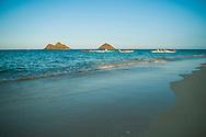 Outrigger canoes off Lanikai Beach, Mokulua Islands offshore, Kailua Bay, Oahu, Hawaii