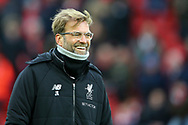 Liverpool Manager Jurgen Klopp looks on smiling. Premier League match, Liverpool v Leicester City at the Anfield stadium in Liverpool, Merseyside on Saturday 30th December 2017.<br /> pic by Chris Stading, Andrew Orchard sports photography.