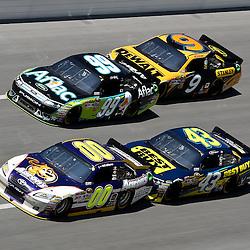 April 17, 2011; Talladega, AL, USA; NASCAR Sprint Cup Series driver David Reutimann (00) leads A.J. Allmendinger (43), Carl Edwards (99) and Marcos Ambrose (9) during the Aarons 499 at Talladega Superspeedway.   Mandatory Credit: Derick E. Hingle