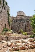 """Yehi'am Fortress National Park is an Israeli national park in the western Upper Galilee, Israel The structure is based on the Crusader-time Iudyn Castle built by the Teutonic Order after 1220, destroyed by the Mamluk sultan Baibars sometime between 1268 and 1271, rebuilt and expanded by Zahir al-Umar as Qal'at Jiddin (Jiddin Castle) in the 1760s and destroyed again by Ahmed Jezzar Pasha around 1775. The ruined fortress, known as Khirbat Jiddin (lit. """"ruins of Jiddin""""), was later inhabited by Bedouin tribes. The buildings include a watch tower with a lookout platform, mosque, and large vaulted hall. The 1948 trenches laid around the castle can also be visited."""