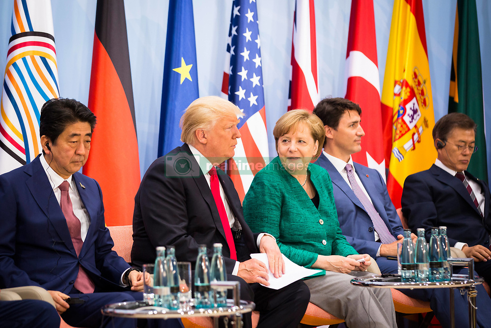 July 8, 2017 - Hamburg, Germany - German Chancellor Angela Merkel, center, sits with U.S. President Donald Trump during the Women's Entrepreneurship Finance Initiative launch event held during the G20 Summit Meeting July 8, 2017 in Hamburg, Germany. (Credit Image: © Sandra Steins/Planet Pix via ZUMA Wire)
