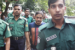 August 29, 2017 - Dhaka, Bangladesh - Bangladeshi security personnel escort Sohel Rana, owner of the collapsed Rana Plaza building, after a court appearance in Dhaka on August 29, 2017. A Bangladesh court on August 29 jailed the Rana Plaza owner for three years for graft, the first of many charges laid against him after the garment factory complex collapsed in 2013 and killed more than 1,134 people. (Credit Image: © Suvra Kanti Das via ZUMA Wire)