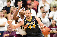Missouri's Ryan Rosburg (44) backs down Texas A&M's Tavario Miller (42) during the second half of an NCAA college basketball game, Saturday, Jan. 23, 2016, in College Station, Texas.  Texas A&M won 66-53.  (AP Photo/Sam Craft)