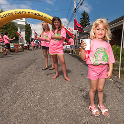 Great Cranberry Island Ultra 50K road race: young race volunteer with water