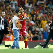 Galatasaray's Felipe Melo (CR) with supporter and security during their Turkish Super League soccer match Galatasaray between Kasimpasa at the TT Arena at Seyrantepe in Istanbul Turkey on Monday 20 August 2012. Photo by TURKPIX