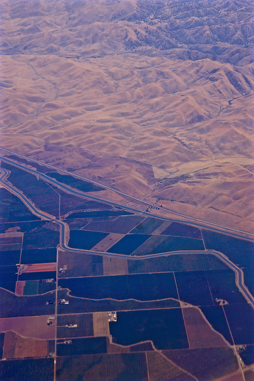 Aerial, edge of productive Central Valley and the Sierra Nevada mountains