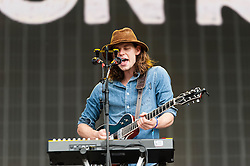 © Licensed to London News Pictures. 12/07/2014. London, UK.   Half Moon Run performing live at Hyde Park as part of the British Summer Time series of outdoor concerts.   In this picture - Conner Molander. Half Moon Run are a Canadian indie rock band  consisting of members Devon Portielje (vocals/guitar), Dylan Phillips (vocals/drums), Conner Molander (guitar/keyboard/vocals), and Isaac Symonds (vocals/percussion/mandolin/keyboard/guitar).  Photo credit : Richard Isaac/LNP