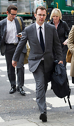 © London News Pictures. 08/05/2012. London, UK. Former News of the World editor ANDY COULSON (centre) arriving at the Rpoyal Courts of Justice in London on May 8, 2012 to make an application to appeal against High Court ruling that Newsgroup Newspapers is not liable for his legal fees in phone hacking actions. Photo credit: Ben Cawthra/LNP