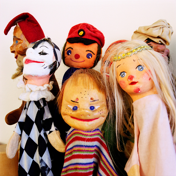 French puppets with scary, eerie faces.