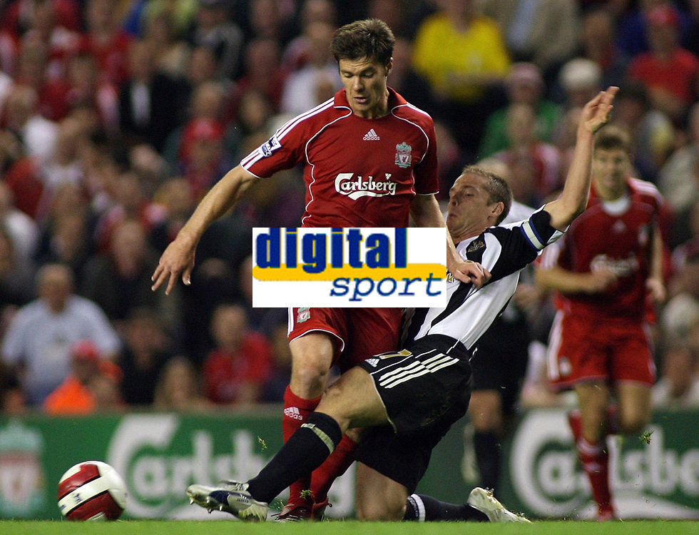 Photo: Paul Thomas.<br /> Liverpool v Newcastle United. The Barclays Premiership. 20/09/2006.<br /> <br /> Xabi Alonso of Liverpool gets tackled by Scott Parker (R).