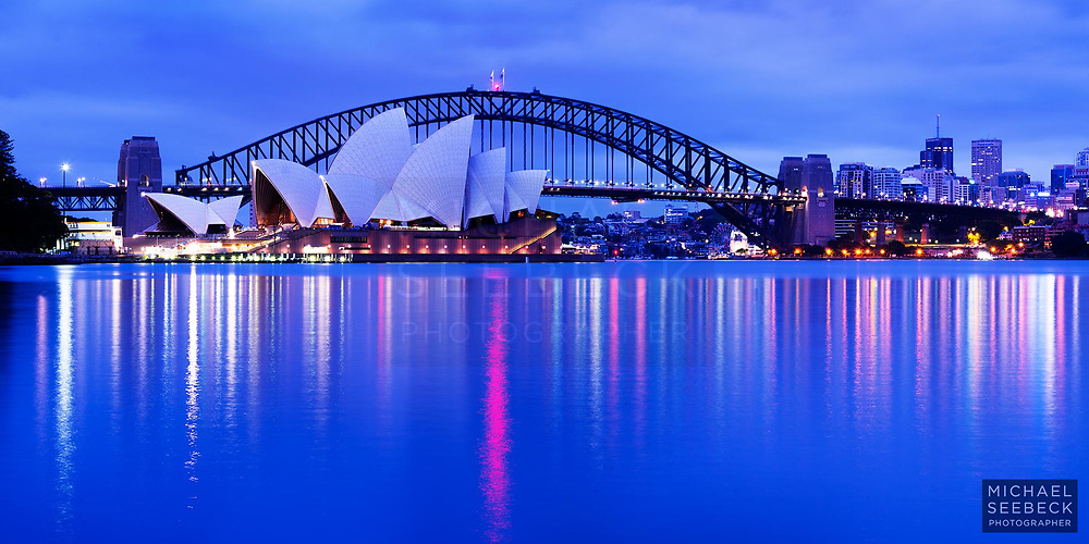 A photograph of Sydney Harbour featuring the Sydney Opera House and Harbour Bridge, taken in early dawn twilight.<br /> <br /> Code: BANM0001<br /> <br /> Limited Edition Print