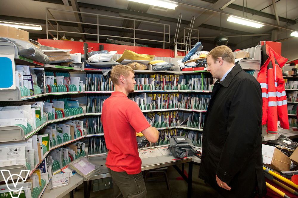 Toby Perkins MP, right, talks to Ben Brookes during his visit to the Royal Mail's Staveley Delivery Office, in Chesterfield.<br /> <br /> Date: November 28, 2014