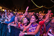 An enthusiastic audience crowds the stage to see Eddie Palmieri. The program was primarily salsa.