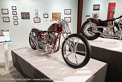 Majik Mike Designs' Mike Rabideau's Bloody Knuckle S&S Knucklehead chopper on display in the Michigan based builder Brandon Keene's Showtime 1976 Harley Davidson FXE on display in the What's the Skinny Exhibition (2019 iteration of the Motorcycles as Art annual series) at the Sturgis Buffalo Chip during the Sturgis Black Hills Motorcycle Rally. SD, USA. Friday, August 9, 2019. Photography ©2019 Michael Lichter.