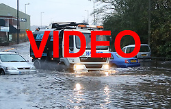 **VIDEO AVAILABLE HERE: http://tinyurl.com/j2nxv79<br /> <br /> © Licensed to London News Pictures. 22/11/2016. Rotherham, UK. Abandoned cars are submerged on a flooded road in Rotherham, South Yorkshire, after a river broke it's banks last night. Storm Angus has brought heavy wind and rain to much of the UK this week with flooding seen all over. Photo credit : Ian Hinchliffe/LNP