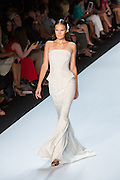 White strapless gown with a flared bottom. By Monique Lhuillier at Spring 2013 Fall Fashion Week in New York.