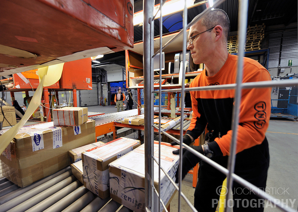TNT NV employees, process packages at the TNT  depot in Brussels, Belgium, Thursday, Feb. 12, 2009. (Photo © Jock Fistick)
