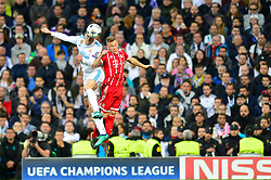 May 2, 2018 - Madrid, Spain - MADRID, SPAIN. May 1, 2018 - Bale and Kimmich jump for the ball. With a 2-2 draw against Bayern Munchen, Real Madrid made it to the UEFA Champions League Final for third time in a row. Kimmich and James scored for the german squad while Karim Benzema did it twice for los blancos. Goalkeeper Keylor Navas had a great night with several decisive interventions. (Credit Image: © VW Pics via ZUMA Wire)