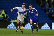 Jack Grealish of Aston Villa (l) challenges Craig Noone of Cardiff city. .EFL Skybet championship match, Cardiff city v Aston Villa at the Cardiff City Stadium in Cardiff, South Wales on Monday 2nd January 2017.<br /> pic by Andrew Orchard, Andrew Orchard sports photography.