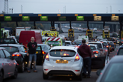 © Licensed to London News Pictures . 15/11/2014 . Kent , UK . Drivers get out of their cars . Traffic backs up across the Dartford Crossing bridge as the toll on the south side of the crossing closes without notice this morning (Saturday 15th November 2014) . Photo credit : Joel Goodman/LNP