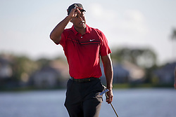 February 25, 2018 - Palm Beach Gardens, Florida, U.S. - Tiger Woods tips his hat to the crowd after completing the 18th hole during the final round of the 2018 Honda Classic at PGA National Resort and Spa in Palm Beach Gardens, Fla., on Sunday, February 25, 2018. (Credit Image: © Andres Leiva/The Palm Beach Post via ZUMA Wire)