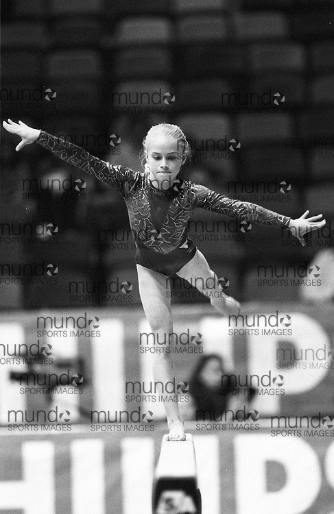 (Ottawa, Canada---16 May 1997)  competes on the balance beam at the 1997 Canadian Gymnastics Championships. Sean Burges / Mundo Sport Images, 1997. www.mundosportimages.com ***** NOTE: Contact us if you wish to order this photo. We will clean it before sale to remove spots *****