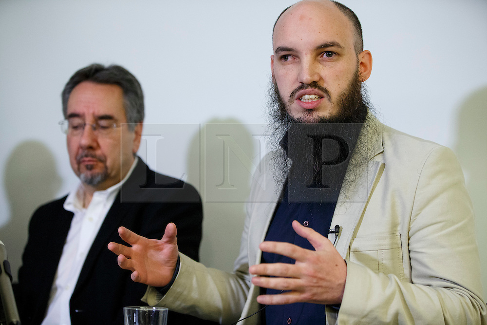 © Licensed to London News Pictures. 26/02/2015. LONDON, UK. Cerie Bullivant (R) from CAGE human rights organisation talk to media about British man Mohammed Emwazi, who believed to be Islamic State militant known as 'Jihadi John' during a press conference in central London on Thursday, 26 February 2015. Photo credit : Tolga Akmen/LNP