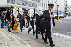 London, UK. 11 October, 2019. Climate activists from Extinction Rebellion dressed as creatures facing extinction arrive to assist in the blocking of the main entrance to the BBC's New Broadcasting House on the fifth day of International Rebellion protests. Activists were demanding that the broadcaster 'tell the truth' regarding the climate emergency.