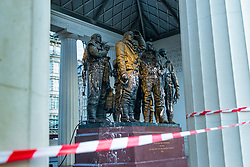 The memorial is cordoned off as Specialist clean-up workers prepare to use high pressure steam to clean the paint vandals squirted over the Bomber Command Memorial in Green Park in the early hours of Monday 21 January. The operation is expected to take at least a day. London, January 22 2019.